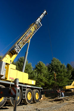 picture of crane lowering storage tank into place